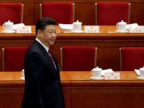Chinese President Xi Jinping arrives the opening session of the National People's Congress (NPC) at the Great Hall of the People in Beijing