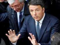 FILE PHOTO: PD party leader Matteo Renzi gestures during a political rally in Naples