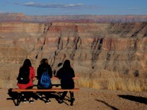Tourists look at the view from Guano Point on the west rim of the Grand Canyon on the Hualapai Indian Reservation