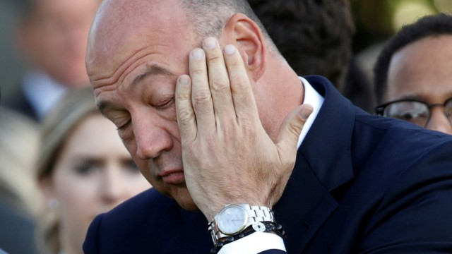 FILE PHOTO:   Trump's economic adviser Gary Cohn wipes his eye before observing a moment of silence in remembrance of those lost in the 9/11 attacks at the White House in Washington