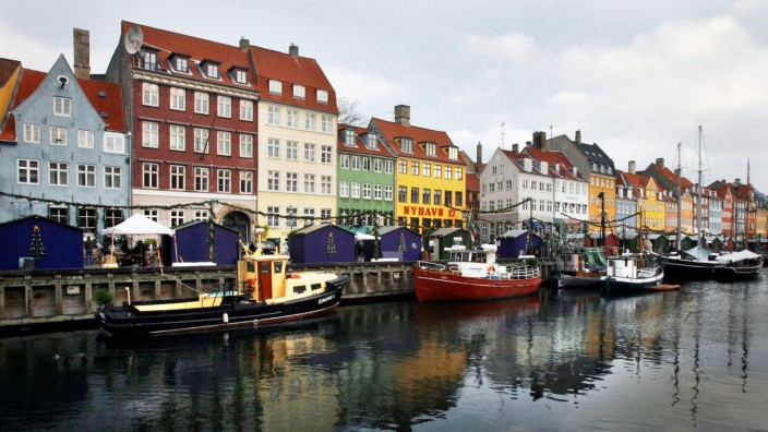 Boats are seen anchored at the 17th century Nyhavn district, home to many shops and restaurants in Copenhagen