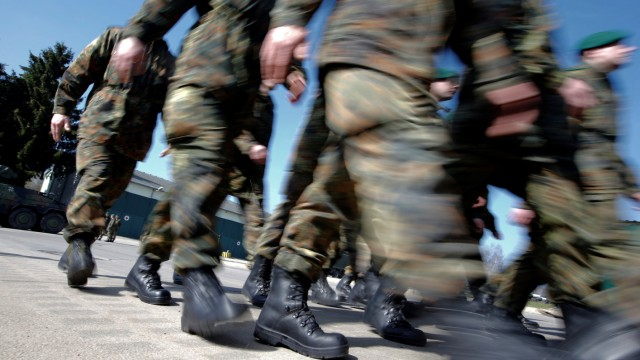 FILE PHOTO: German Bundeswehr armed forces soldiers of the 371st armoured infantry battalion march during a media day of the NATO drill 'NOBLE JUMP 2015' at the barracks in Marienberg