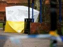 A tent covers the park bench where former Russian intelligence agent Sergei Skripal and his daughter Yulia were found after they were poisoned, in Salisbury.