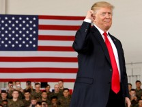 FILE PHOTO: U.S. President Donald Trump pumps his fist after speaking at Marine Corps Air Station Miramar in San Diego, California