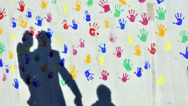 Schatten - Mann mit Kindern