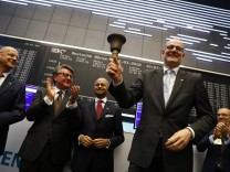 Bernd Montag, CEO of Siemens Healthineers rings the bell for the official share trading start following an initial public offering (IPO) at the trading floor of FrankfurtâÄÖs stock exchange in Frankfurt