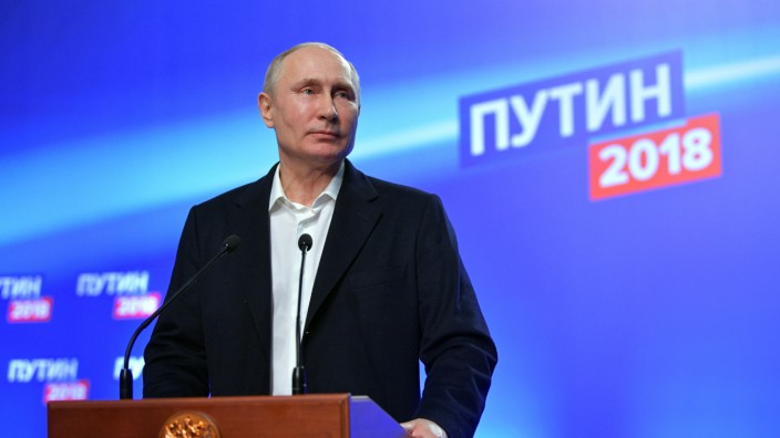 Russian President and Presidential candidate Putin attends a news conference at his campaign headquarters in Moscow