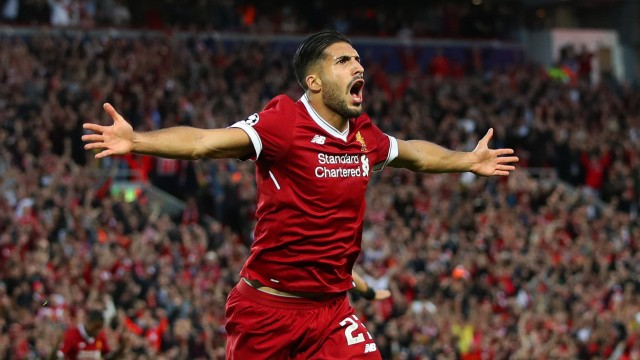 Emre Can of Liverpool celebrates the opening goal during the Champions League playoff round at the A
