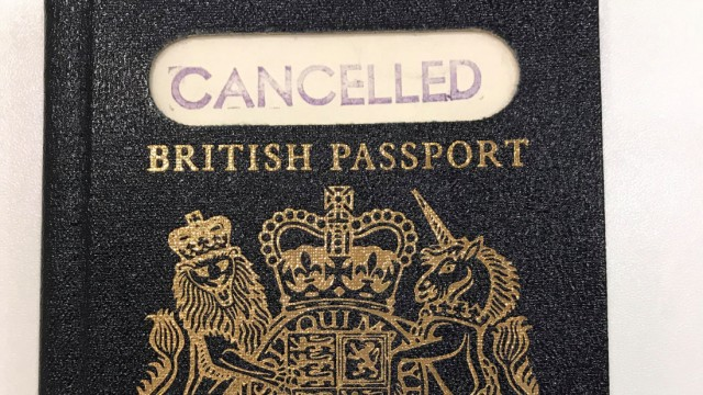 A handout photograph shows the original 'blue' British passport, which was subsequently replaced by the burgundy EU British passport, supplied by the UK government in London,