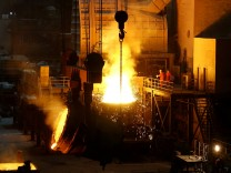 Workers are seen at a steel mill of Dongbei Special Steel in Dalian