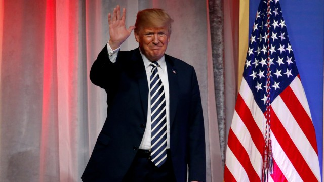 FILE PHOTO: U.S. President Donald Trump delivers remarks at the National Republican Congressional Committee's annual March dinner at the National Building Museum in Washington