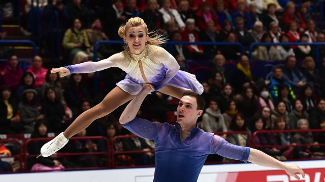 Das deutsche Eiskunstlauf-Paar Aljona Savchenko and Bruno Massot gewinnen die Eiskunstlauf-Weltmeisterschaft 2018 in Mailand.