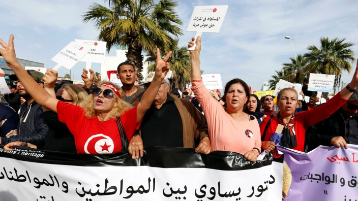Protesters shout slogans during a march, demanding equal inheritance rights for women, in Tunis