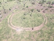 Aerial photo of site Mt05, a circular enclosure (140 m diameter) located on a hilltop.