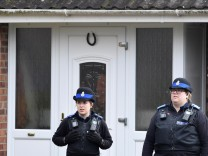 Police officers stand guard outside of the home of former Russian military intelligence officer Sergei Skripal, in Salisbury