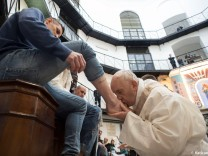 Pope Francis kisses the foot of an inmate at the Regina Coeli prison during the Holy Thursday celebration in Rome