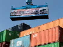 FILE PHOTO: A container is loaded on to the first Chinese container ship to depart after the inauguration of the China Pakistan Economic Corridor port in Gwadar