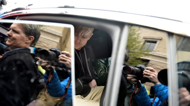 Ethan Couch closes the door to a vehicle that was waiting for him after being released from the Tarrant County Jail in Fort Worth