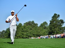Tiger Woods walks on the 15th fairway during a practice round prior to the Masters golf tournament a