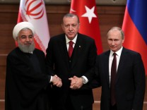 Presidents Rouhani of Iran, Erdogan of Turkey and Putin of Russia hold a joint news conference after their meeting in Ankara