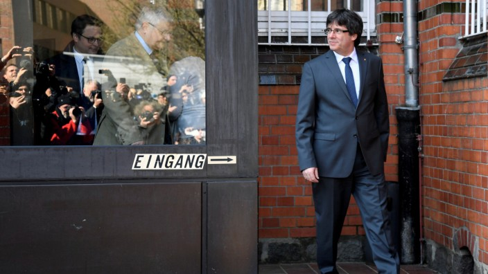 Catalonia's former leader Carles Puigdemont looks on as he leaves the prison in Neumuenster