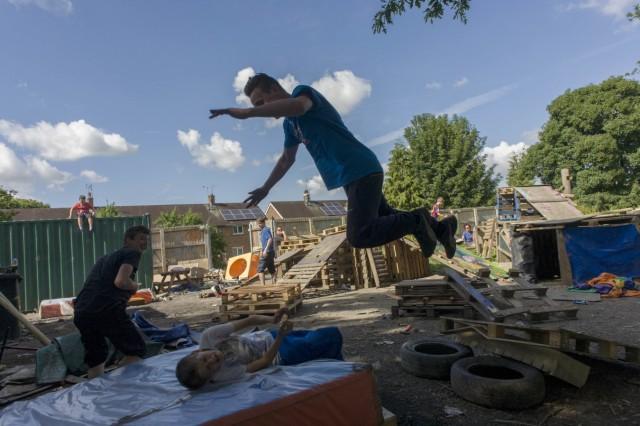UK - Ruabon - Boy somersaults in risk averse playground