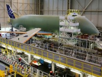 Employees work on an Airbus Beluga XL at the final assembly line at Airbus headquarters in Blagnac, near Toulouse