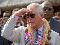 Britain's Prince Charles shades his eyes during a visit to Haos Blong Handikraf, as he visits the South Pacific island of Vanuatu
