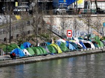 A row of tents where migrants live are installed on the banks of the Canal Saint-Martin in Paris