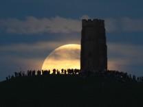 Strawberry Moon Rises Over Glastonbury Tor