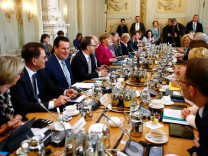 German Chancellor Angela Merkel and Ministers attend at a cabinet session during a retreat at the German government guesthouse Meseberg Palace in Meseberg