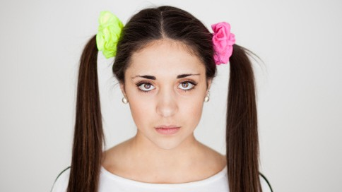 Teen with two ponytails and colourful scrunchies