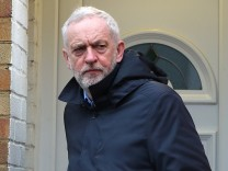 Britain's opposition Labour Party leader Jeremy Corbyn leaves his home in London