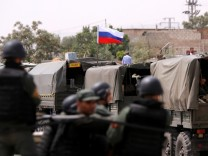 Russian flag is seen on military vehicle at entrance of Wafideen camp in Damascus