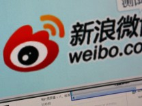 File photo of the logo of Sina Corp's Chinese microblog website 'Weibo' being seen on a screen in this photo illustration taken in Beijing; jetzt Weibo