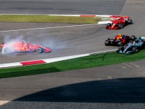 German F1 Sebastian Vettel of Ferrari and Dutch F1 driver Max Verstappen of Red Bull Racing collide