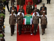 Winnie Madikizela-Mandela's coffin is taken from the Orlando stadium during her funeral service in Soweto