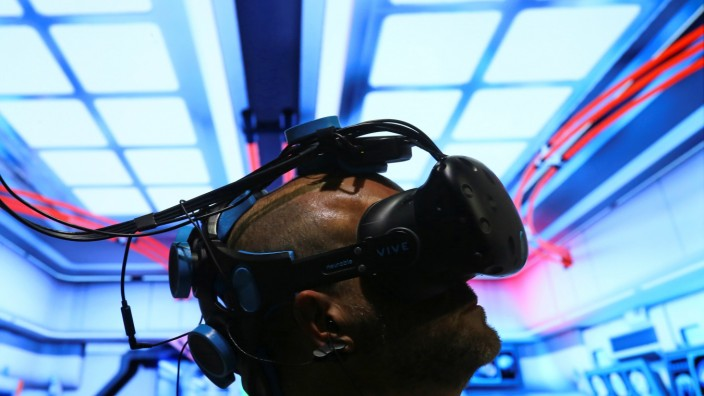 Pablo Holcer tests out a virtual reality system made by Neurable at SIGGRAPH 2017 in Los Angeles, California