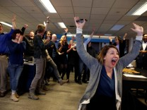 Amber Hunt, reporter Cincinnati Enquirer (R) and other journalists in the Enquirer newsroom celebrate as they learn of winning a Pulitzer Prize for local reporting for their 'Seven Days of Heroin' project in Cincinnati