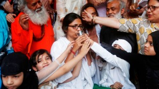 Girls offer juice to Swati Maliwal, chairperson of Delhi Commission for Women, to end her fast during her hunger strike protest demanding stricter laws for rape in India, in New Delhi