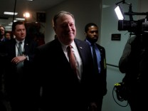 CIA Director Mike Pompeo, President Donald Trump's nominee to be Secretary of State, leaves a meeting with Sen. Mark Warner (D-VA) on Capitol Hill in Washington