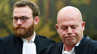 Lawyers Mary and Delcoigne representing Abdeslam look on in the courtroom prior to the announcement of the sentence in the trial of Abdeslam and co-defendant Ayari in Brussels