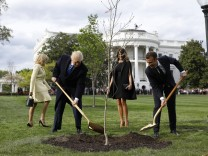 U S President Donald Trump with France s president Emmanuel Macron and First Ladies Melania Trump a