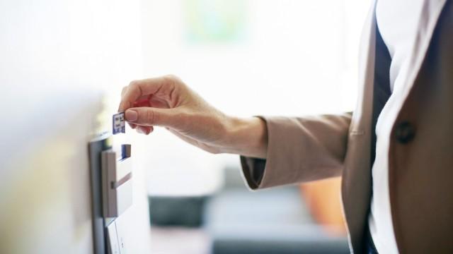 Woman using electronic keycard on hotel room door model released Symbolfoto property released PUBLIC