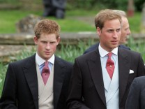 Briain's Prince William and Harry leave following the wedding of Parker Bowles and Lopes in Lacock in west England