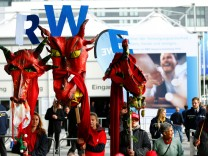 Environmental activists protest against German power supplier RWE outside RWE's annual shareholders meeting in Essen