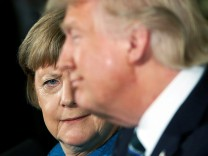 Merkel gives Trump a look during their joint news conference in the East Room of the White House in Washington