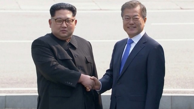 North Korean leader Kim Jong Un shakes hands with South Korean President Moon Jae-in as both of them arrive for the inter-Korean summit at the truce village of Panmunjom, in this still frame taken from video