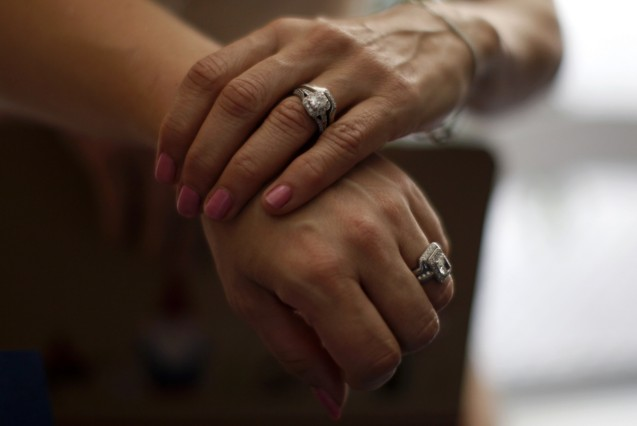 Sallee Taylor, 41, and her wife Andrea Taylor, 41, hold hands after getting married in West Hollywood