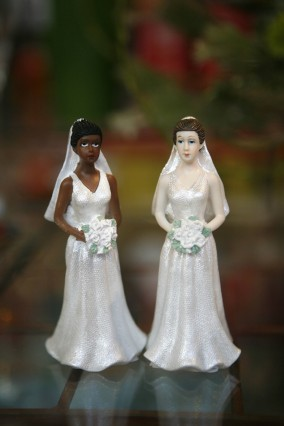 Jul 01 2008 San Francisco California USA Lesbian bride wedding cake toppers in a storefront i